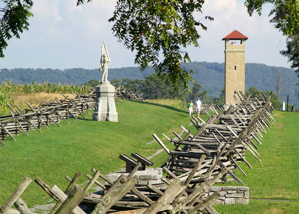 Observation tower, memorial, and picket fence