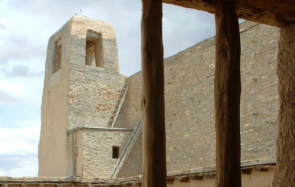 View of Pueblo tower through a wooden window
