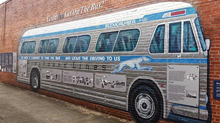 Painting on a brick wall of a Freedoms Rider greyhound bus