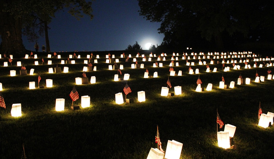 Luminaries on grave sites in a cemetery
