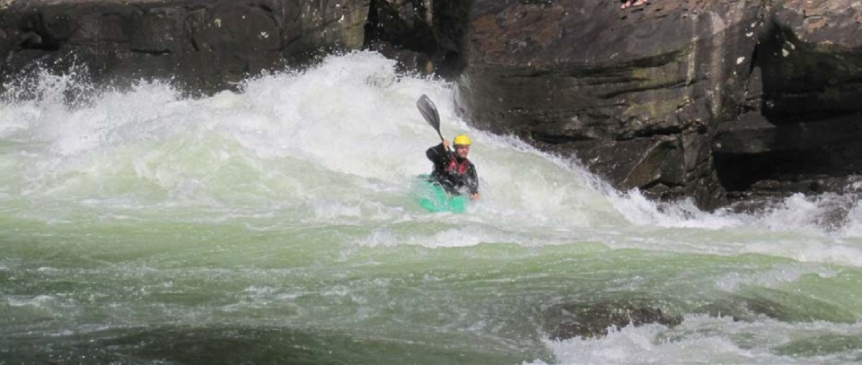 Whitewater paddler in rapids