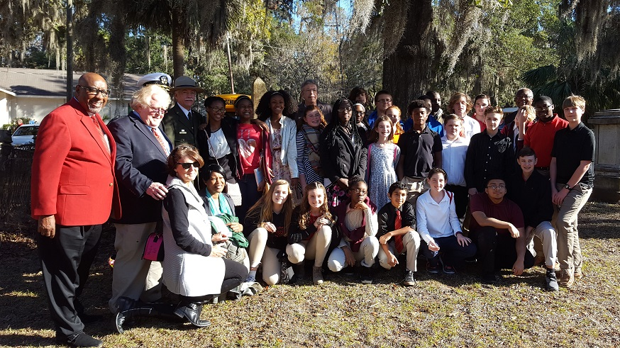 Director Jarvis, Congressman, and group of youth posing for the camera