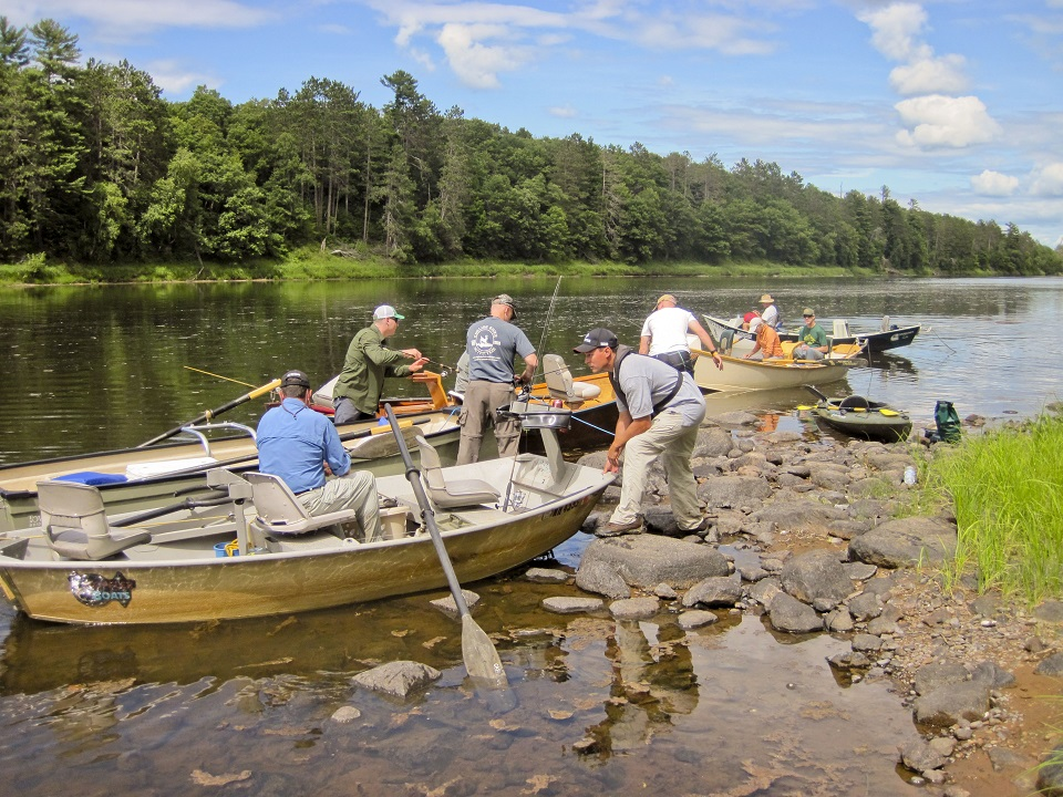 Group of military veterans launching fishing boats