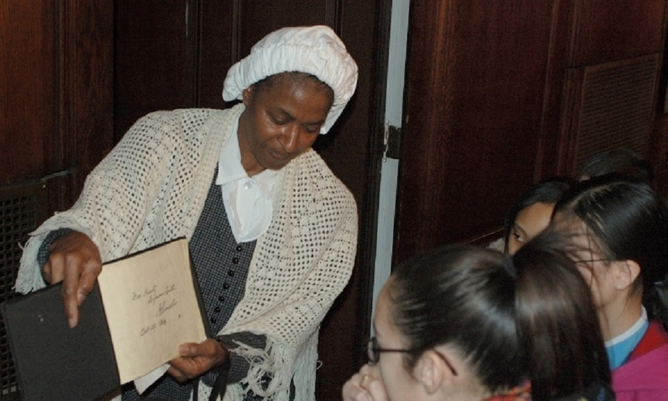 Reenactor portraying Soujourner Truth to two young girls