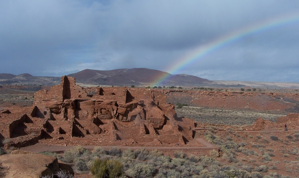 Rainbow over pueblo in the desert
