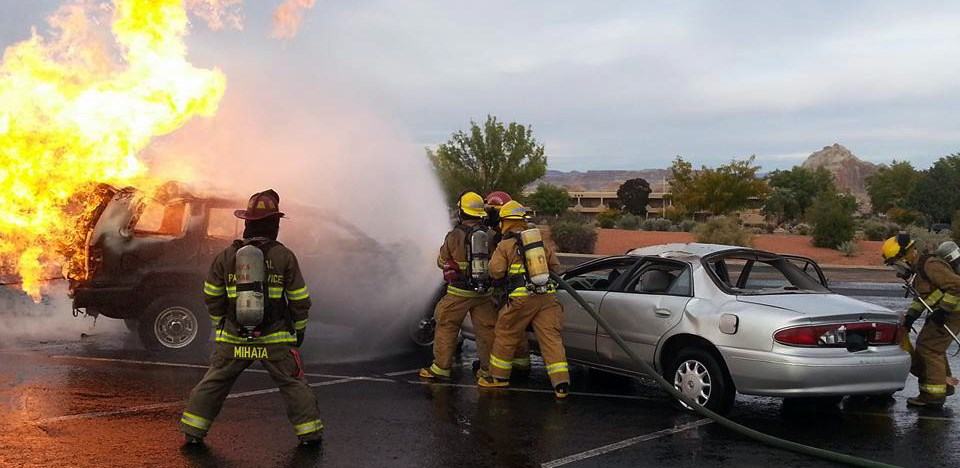 NPS firefighters extinguish a car fire at a fire training workshop.
