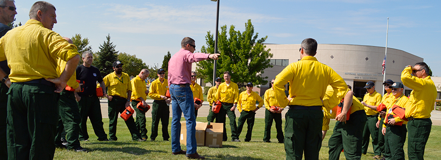 NPS Wildland Fire Training Manager Jim Shultz leads a practice fire shelter training with fire managers.
