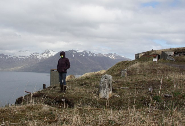 Rhea looking over a bluff at the Aleutians World War II National Historic Area