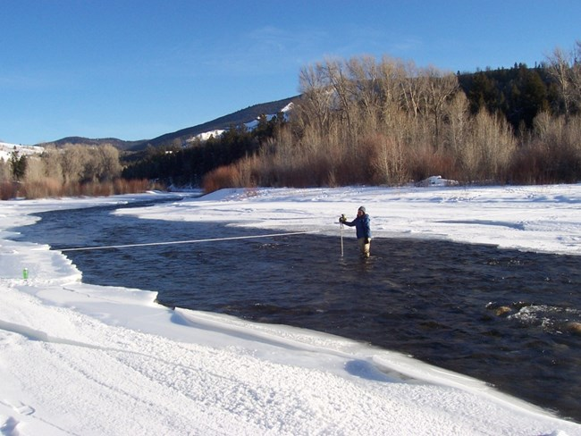 NPS scientist measures flow of river.