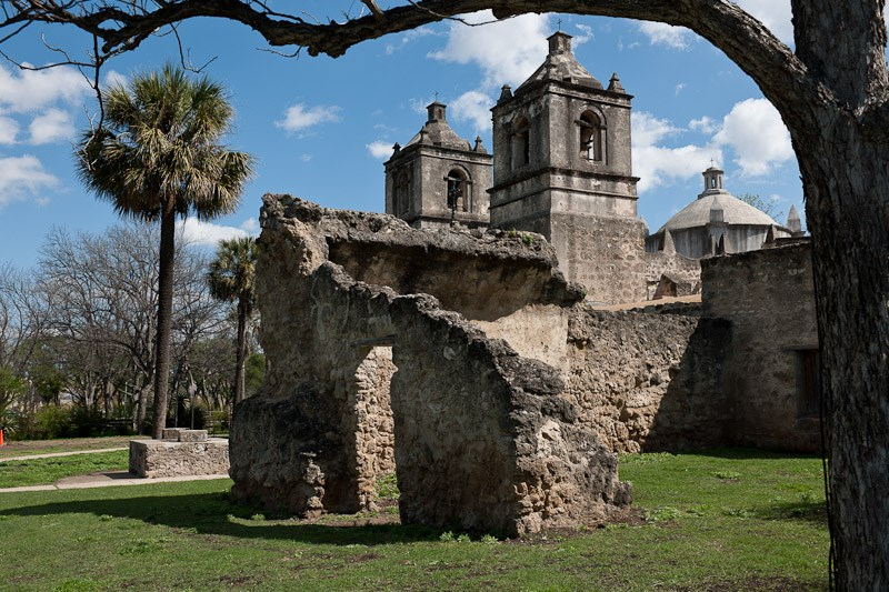 mission ruins from the 1700s with a trees, blue skies, and clouds