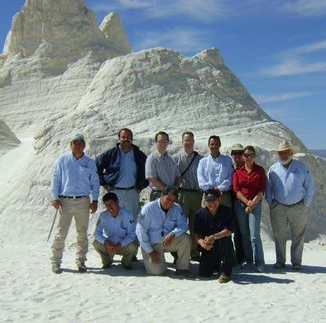 Group of rangers in front of sand formation