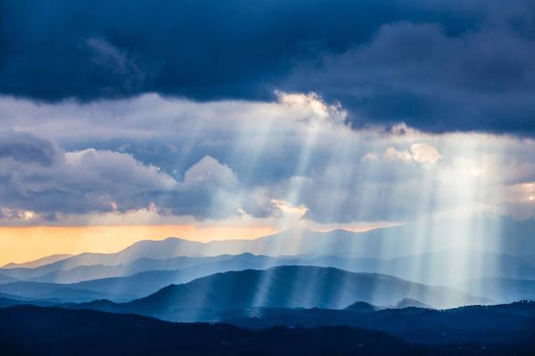NPS photo of clouds and sunbeams above the Blue Ridge Parkway by J Ruff.
