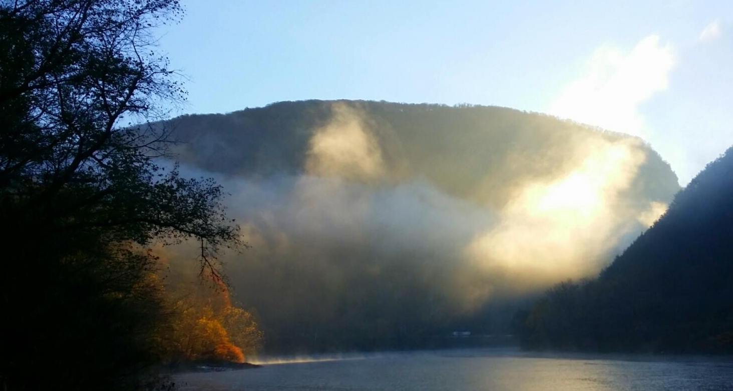 Sunlit mist over the water and fall colors viewed from Kittatinny Point in Delaware Water Gap National Recreation Area. NPS photo by A BeBault.