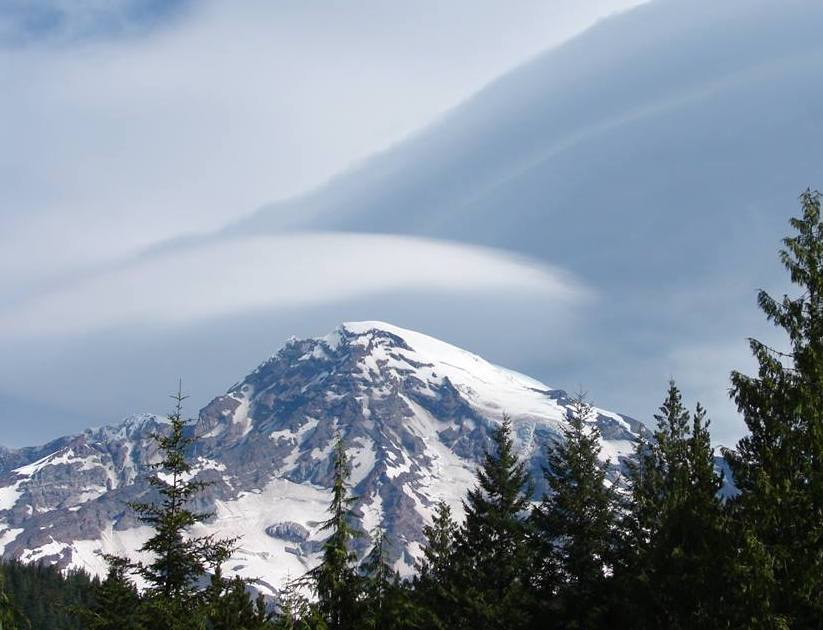Lenticular clouds appear over the summit of Mount Rainier. NPS photo by S Redman.
