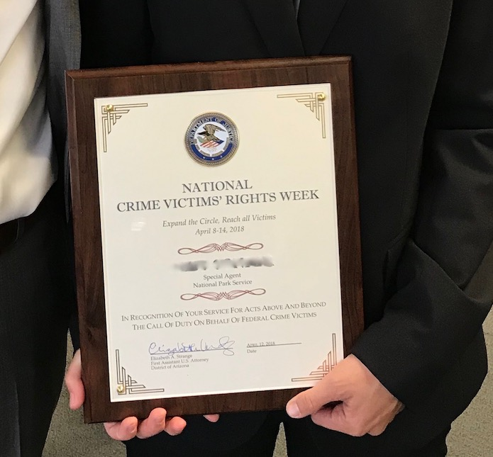 The US Attorney's Office presented an ISB Special Agent with a certificate during National Crime Victims' Rights Week.