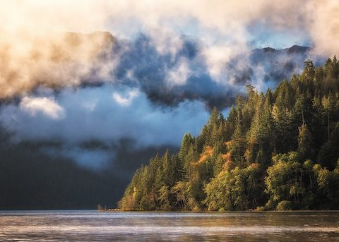 Sunrise lights clouds above Lake Crescent in Olympic National Park. NPS photo by G Longenbaugh.