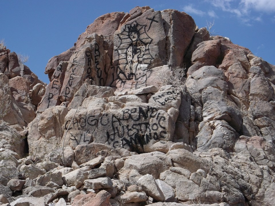 Graffiti painted on natural rock structures in Organ Pipe Cactus National Monument. NPS photo.