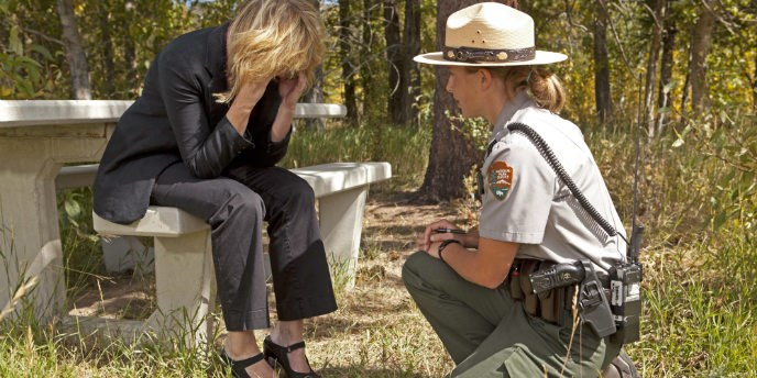 A US Park Ranger provides support to a distraught person.