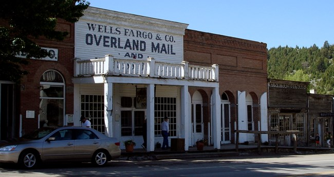 Streetscape in Virginia City (MT) showing Overland Mail office.