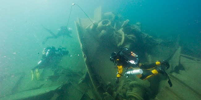 Divers underwater at the Glenlyon wreck