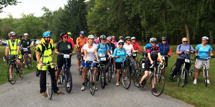 Group of cyclists stop for a photo along the trail