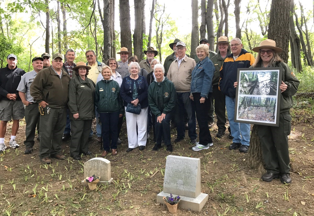 NPS staff and members of the Sorber family in restored cemetary