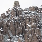 Tall rock spires with a dusting of snow.