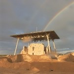 Casa Grande ancient earthen dwelling with a rainbow above