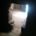 A t-shaped doorway shows light from a second, outer doorway on the floor beyond.