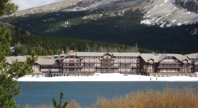 View across lake of the Many Glacier Hotel at Glacier National Park.