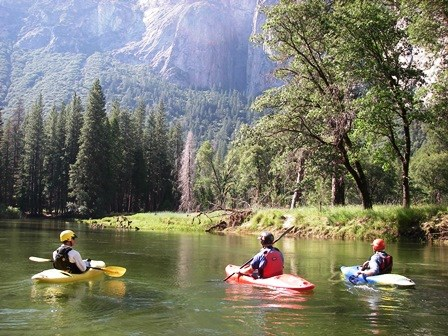 3 people canoeing on the Merced River.