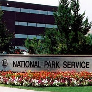 photo of the Denver Service Center building with a National Park Service sign and flowerbed in the foreground.
