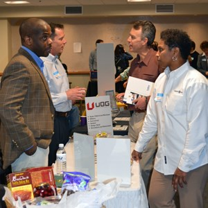 DSC employees visiting with vendors at the small business fair.
