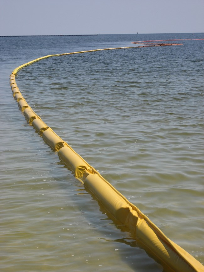 A boom is deployed during spill response on the ocean.