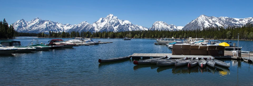 Boats and canoes at Colter Bay Marina on Jackson Lake, Grand Teton National Park