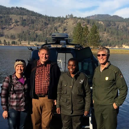 Tinyiko Golele, a park ranger from Kruger, stands with Lake Roosevelt Superintendent and friends.