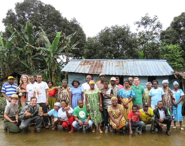 Superintendent Burghart poses with townspeople at a small village in Equatorial Guinea.