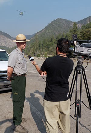 Park ranger gives an interview to inform the public