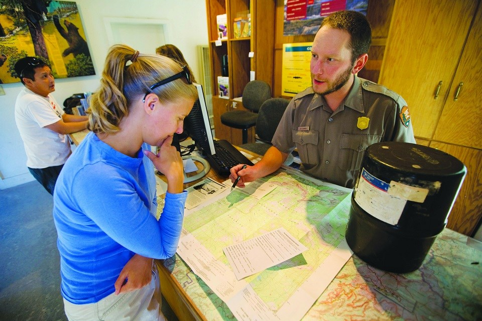 Visitor and ranger discuss trip planning options