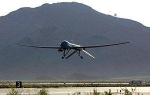 A large unmanned aircraft comes into a runway for a landing.
