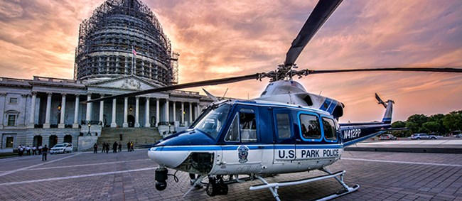 United States Park Police helicopter on plaza in front of U.S. Capitol.