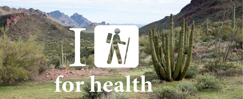Hike for health symbol over the Ajo Mountains