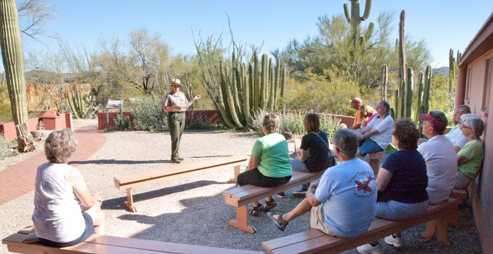 Ranger conducting a patio talk to a crowd at the visitor center