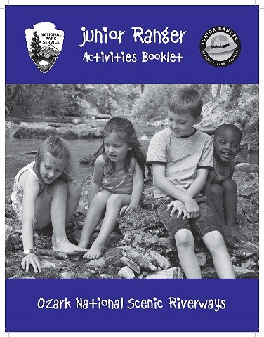 cover of junior ranger book with kids playing in creek
