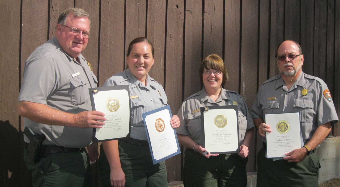 Park employees holding certificates
