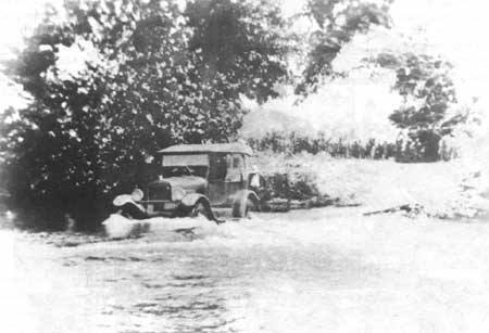 an old car crossing the Jacks Fork River