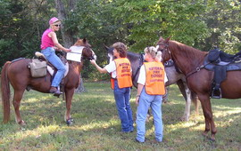 Volunteers talking to horse riders