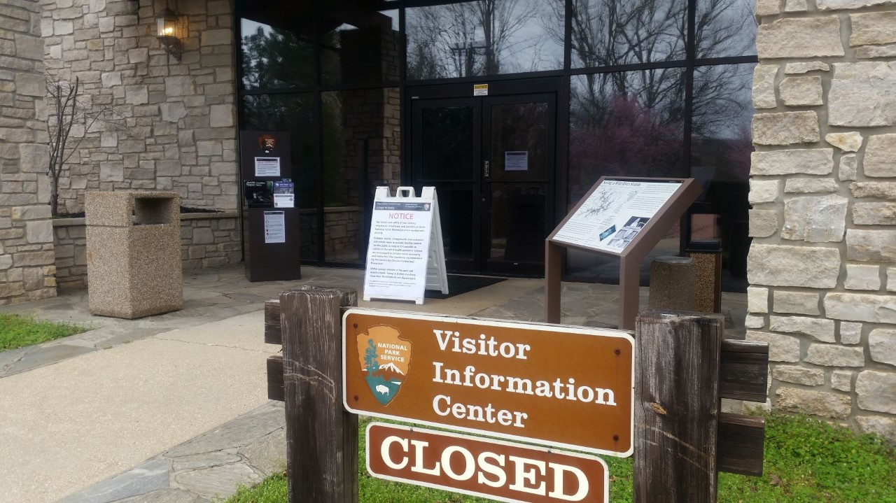 visitor information center sign, with closed