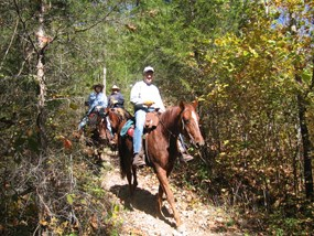 Riders on horseback on trails in the Ozark National Scenic Riverways