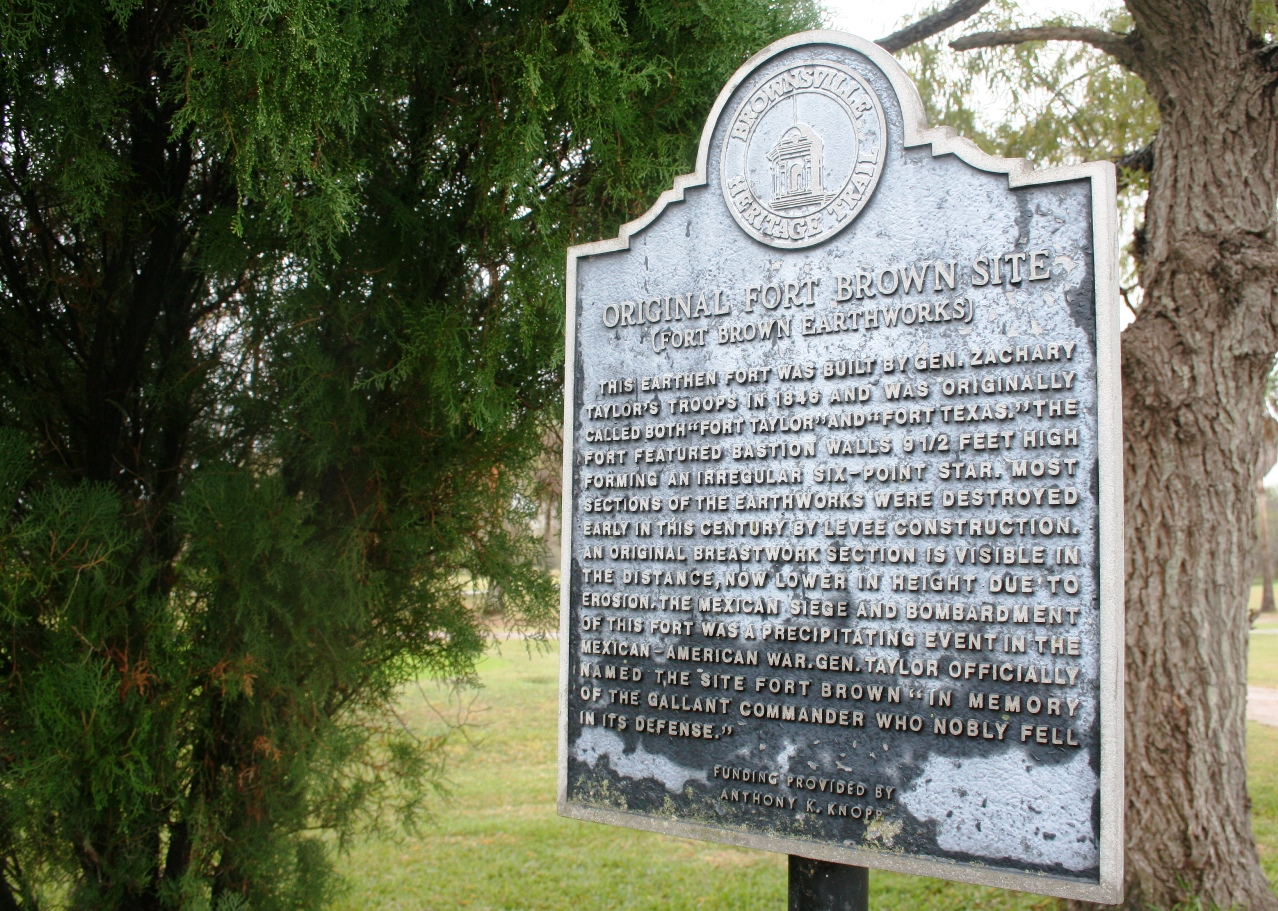 A historical marker for the Fort Brown earth works